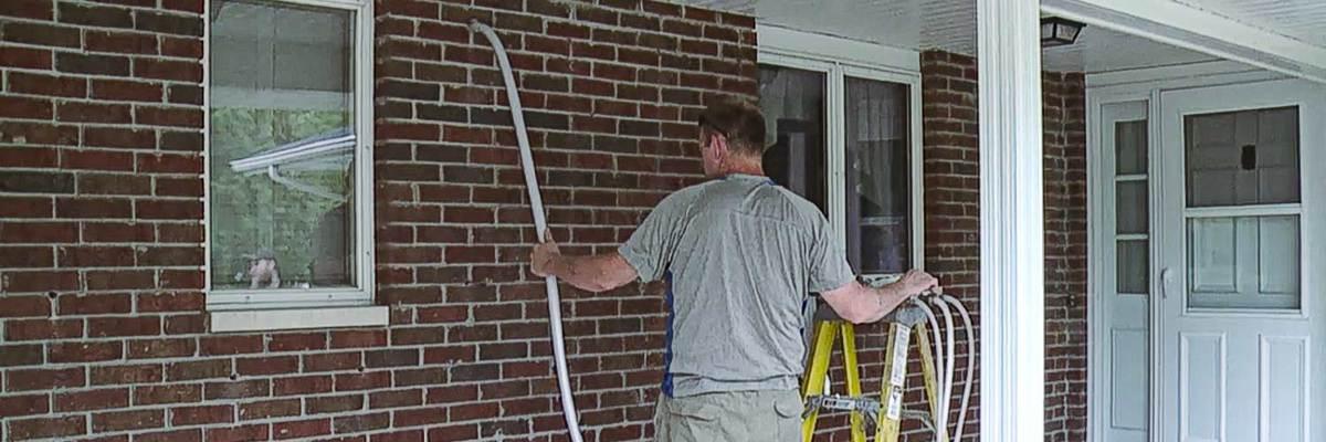 insulating exterior brick walls